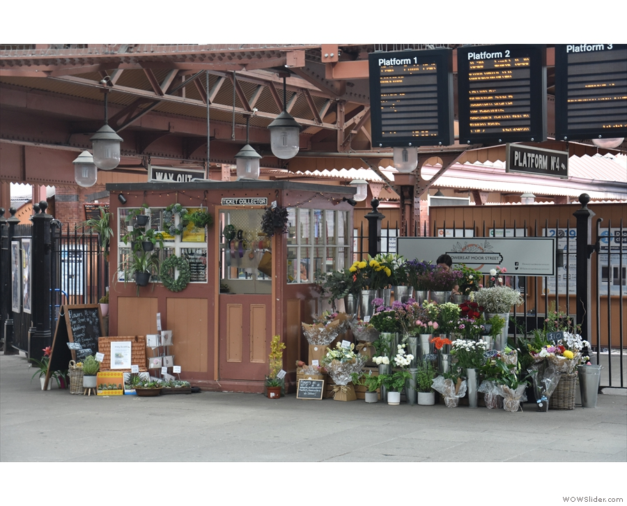 ... ticket inspector's office is now a flower stall, while the new ticket barriers are to its left.