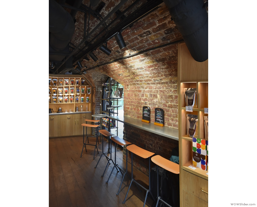 You can find the remaining seating at the back on the right, with this four-person bar...