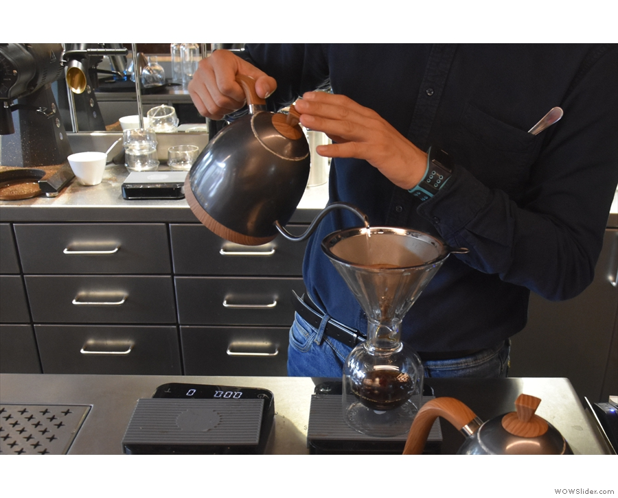 ... the barista carefully, and slowly, pouring the water into the V60.