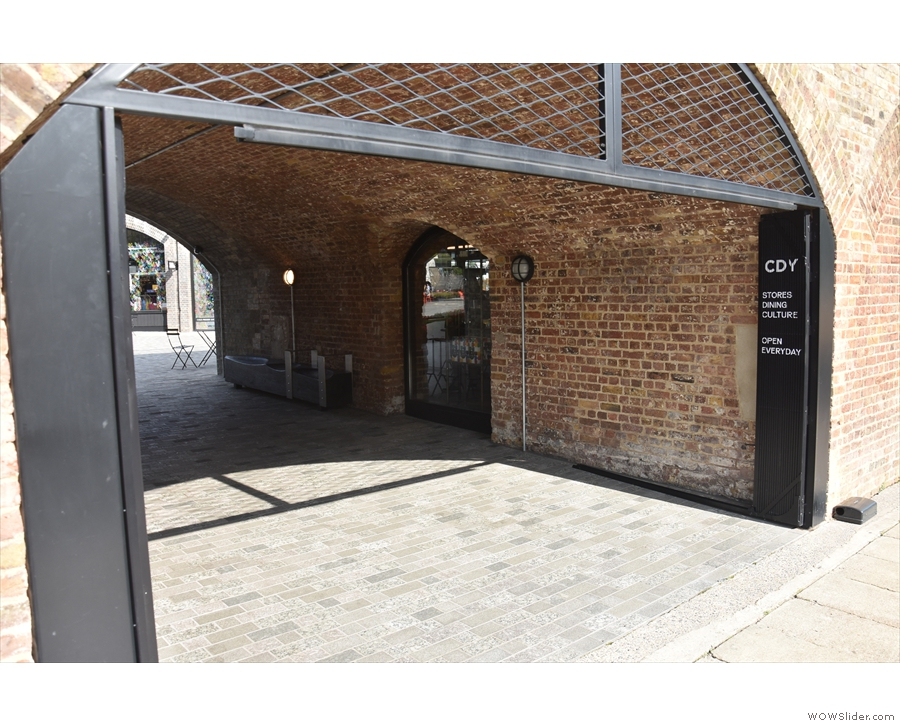 There's one other approach, from the canal towpath through the arch next to Le Cafe...