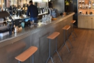 ... where you can sit at one of these four stools, ideal for watching the pour-over.