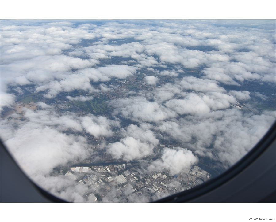 I never tire of looking down on the tops of clouds. There's a city somewhere down there.