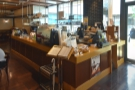 After the retail section, the coffee shop proper starts with the counter on the right...