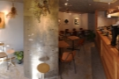 A panoramic view from just inside the door, where the concrete pillar splits Foret in two.