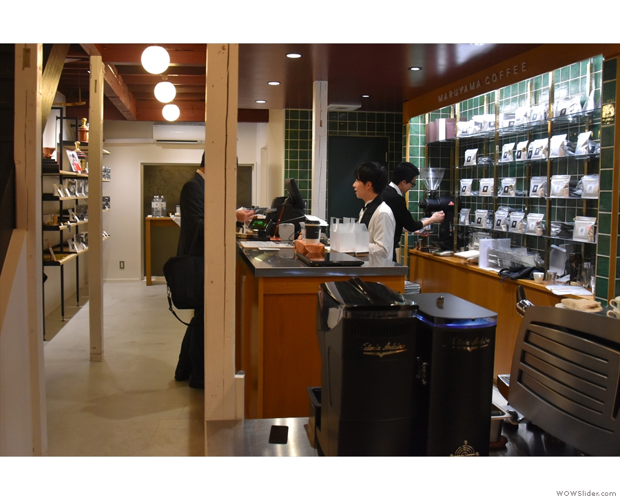 The counter, where you pay, is on the right, with retail shelves on the left and at the back.