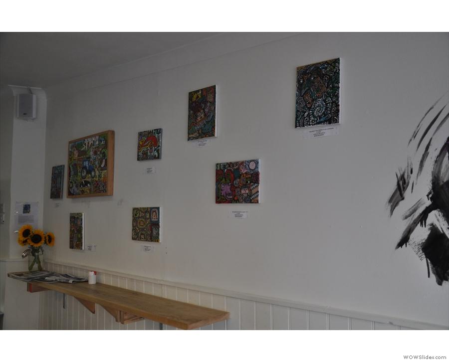 Artwork by local artist, rubandagar, adorns the walls.