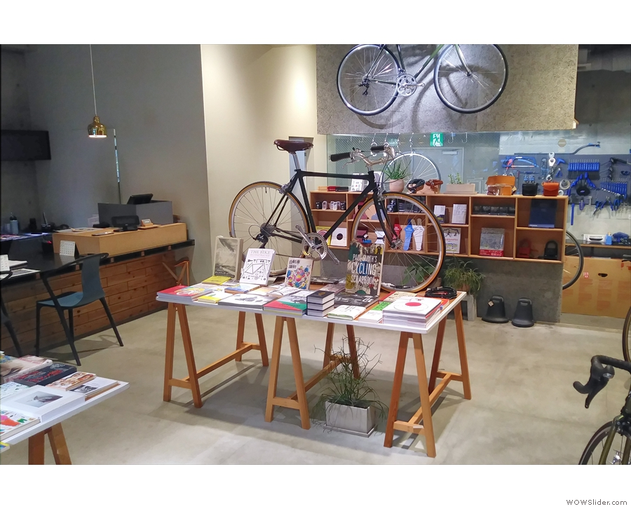 More of the books from the pop-up last week, with the bike workshop behind.