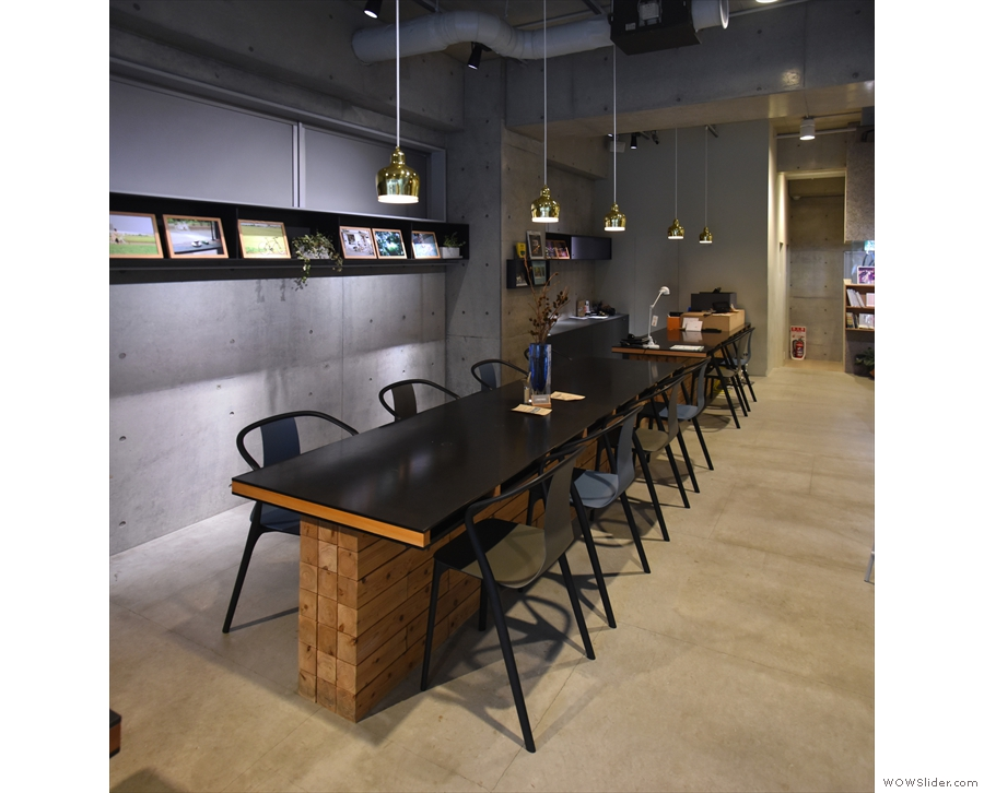 The seating starts with this eight-person communal table after the counter.