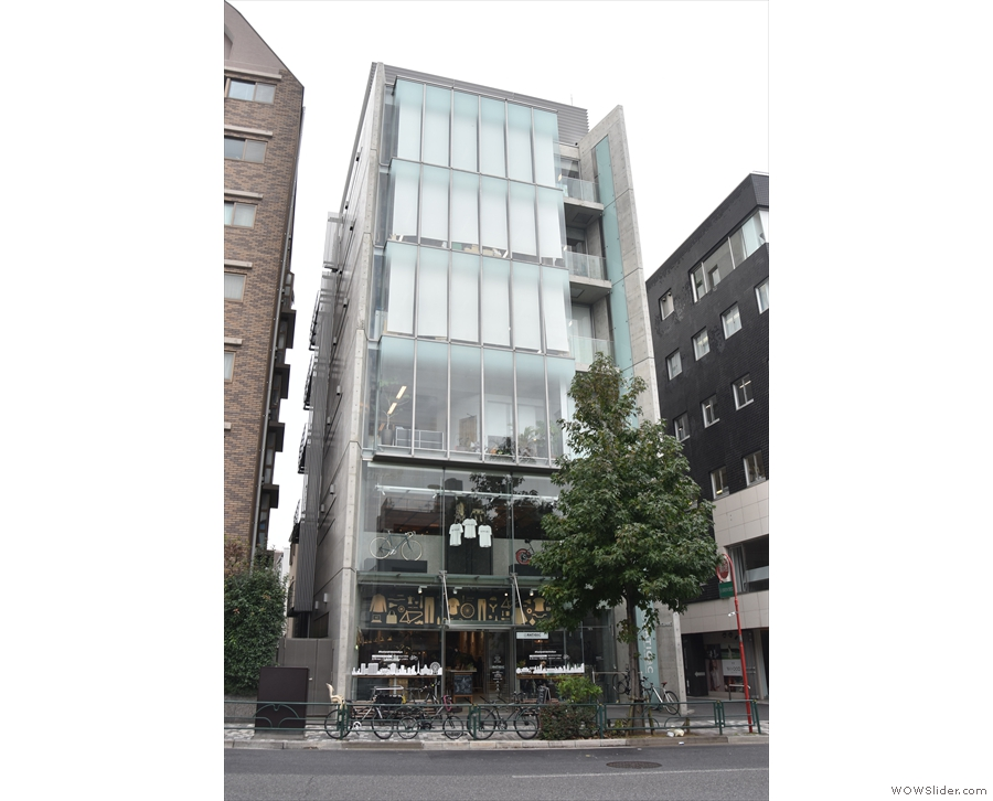 On a busy street in Gaienmae, stands this unremarkable six-storey building. However...