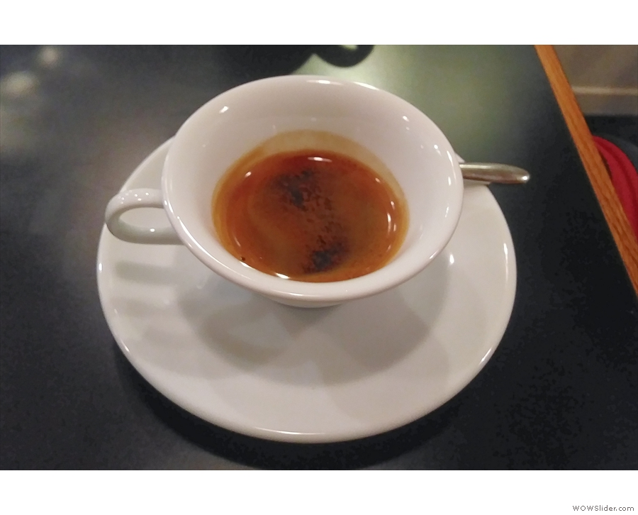 The espresso arrived first, served in a wide-brimmed demitasse cup...
