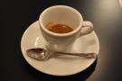 First you get a shot in a classic tulip-shaped espresso cup.