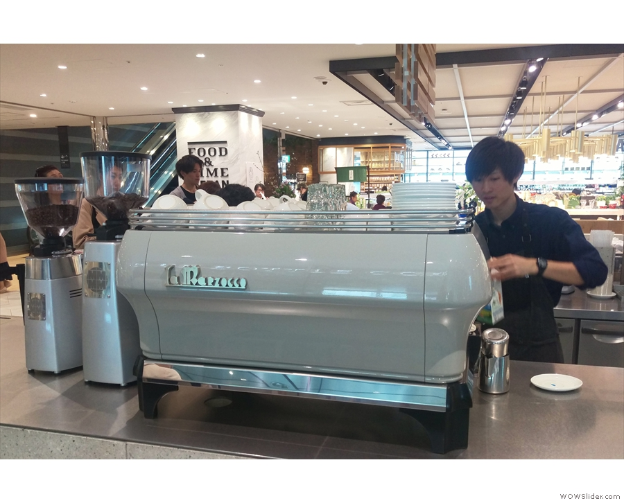... past the La Marzocco FB80 espresso machine and its grinders on the front corner...