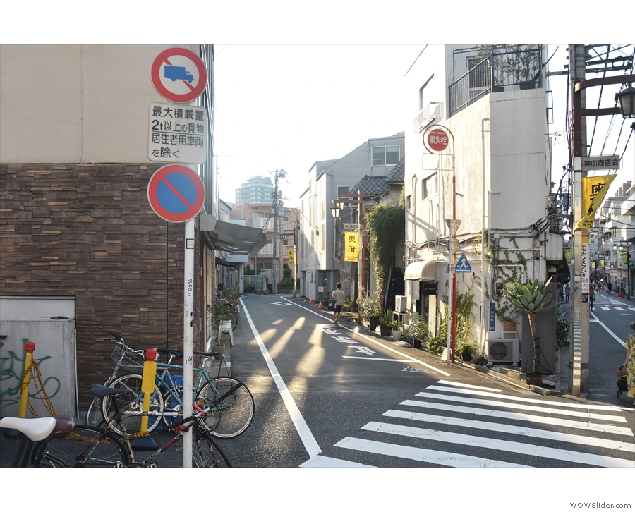 In the tangle of narrow streets north of Shibuya Station, stands (on the left)...