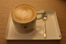 On my first visit, in July 2018, I tried a decaf flat white, served on a small, metal tray...