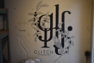 The Glitch logo is on the wall at the front of the roastery section.