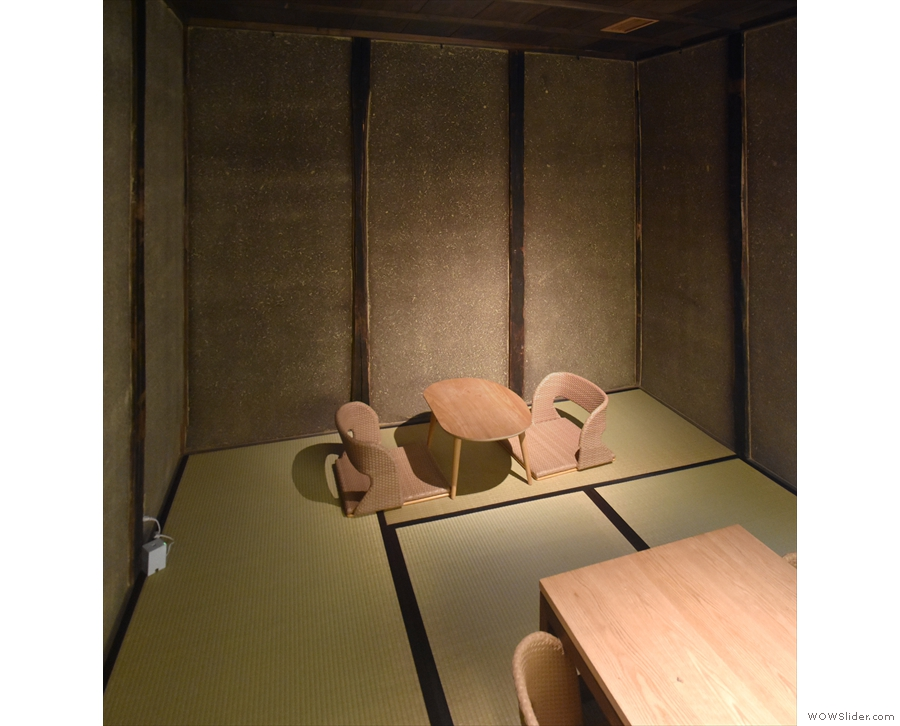 The two-person table in the corner in more detail.