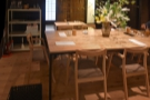 You enter the seating area to find an eight-person communal table in the centre.