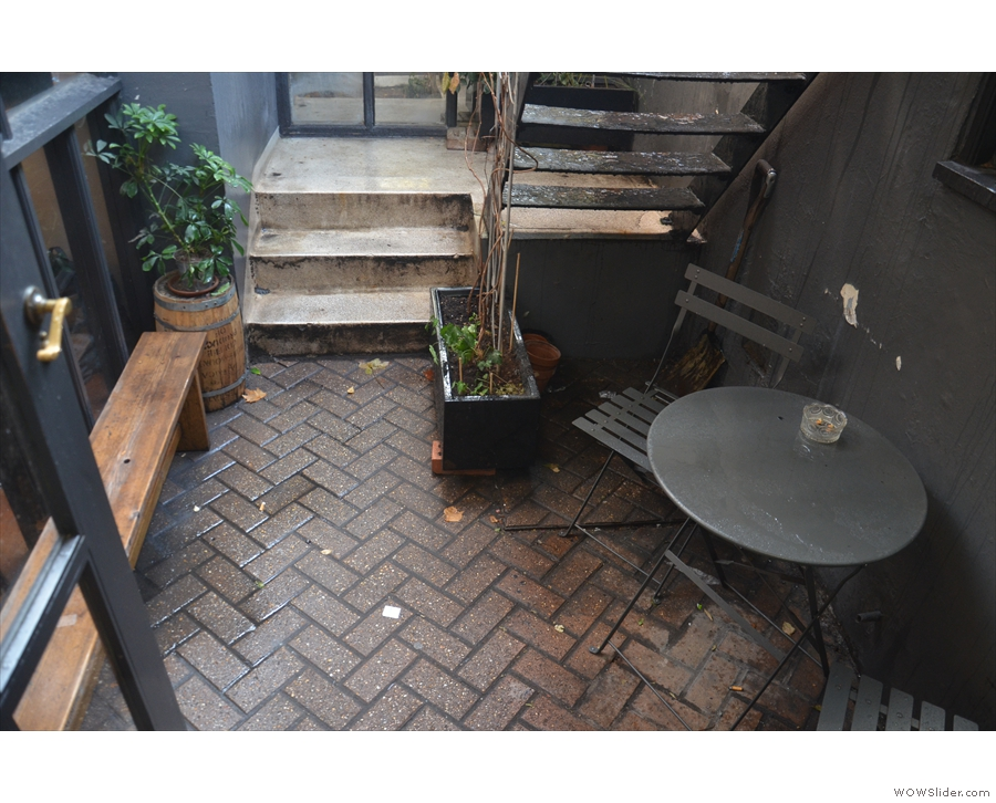 ... to the small basement courtyard. There's a solitary bench under the windows...