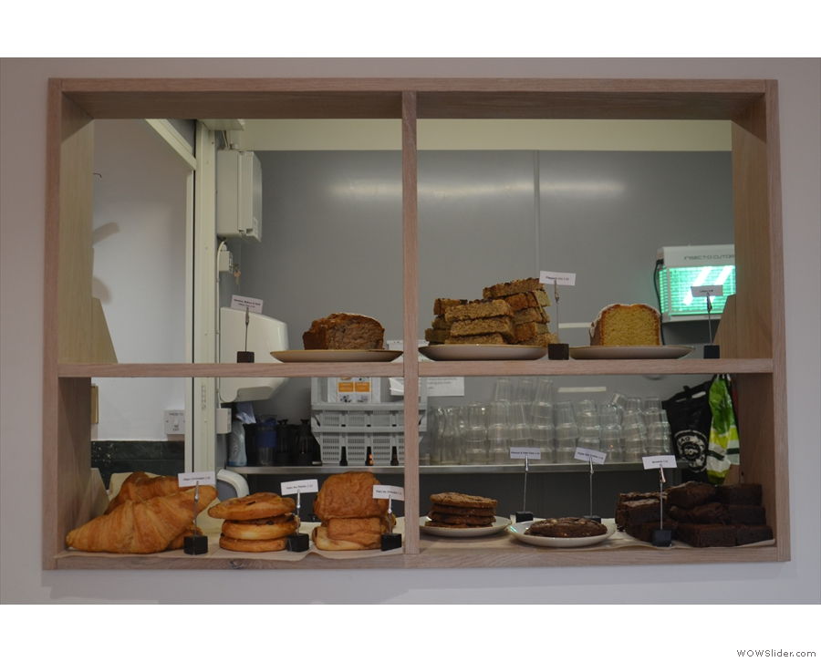 The cakes, meanwhile, are displayed to the right of the counter (with the kitchen behind).