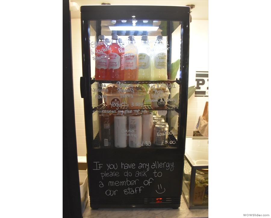 There's also a chiller cabinet with soft drinks on the counter next to the menu.