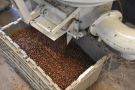 When the beans are cooled, they're deposited into a box from a chute at the bottom.