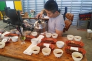 Sharon moves round each bowl in turn with the biggest cupping kettle I've seen!