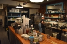 The counter runs down the Rue Rachel side of Café Névé, open kitchen behind it and...