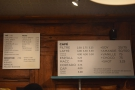 The drinks menus are on the wall behind the counter...