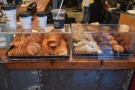 The short side of the counter faces you as enter, laden with pastries and muffins...