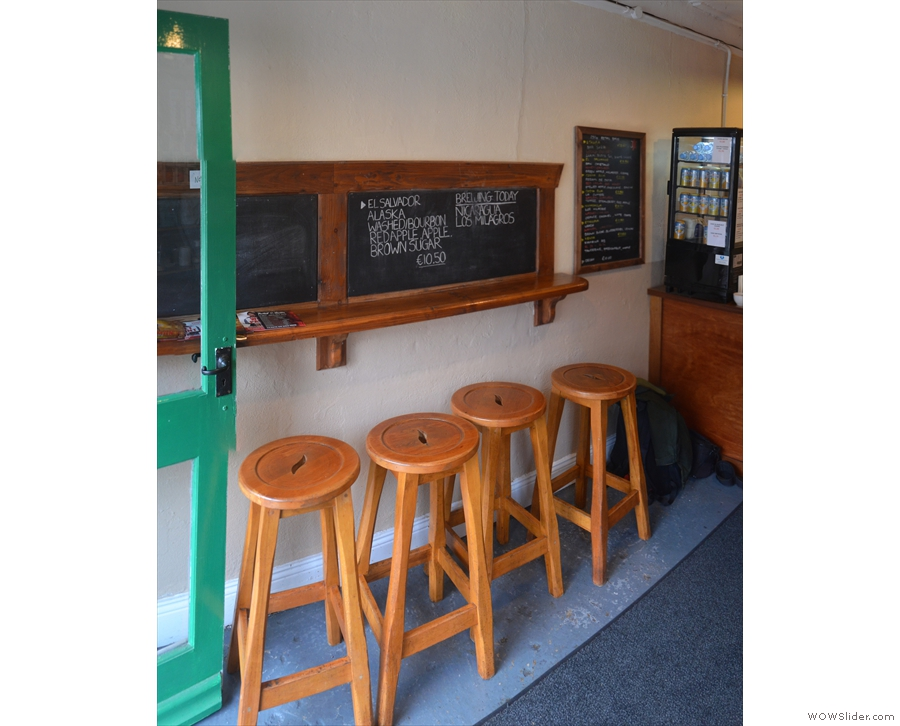 There's a row of four stools against a narrow bar against the left-hand wall...