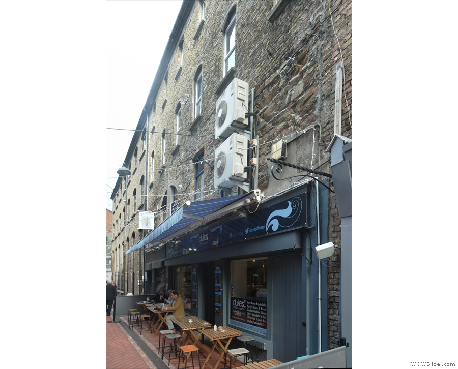 On the narrow Carey's Lane in the heart of Cork, is a four-storey, stone & brick building.
