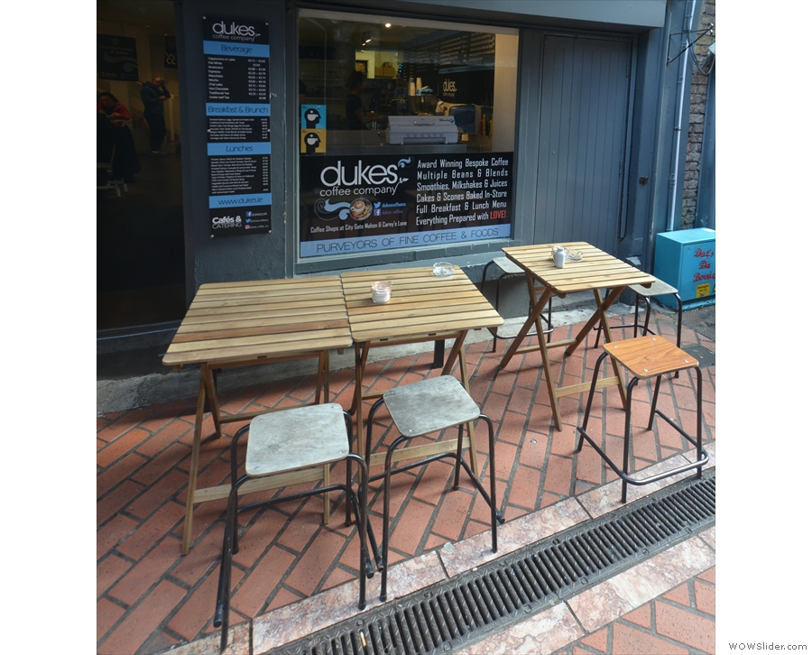 There's outdoor seating, with four of these two-person tables to either side of the door.