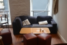 Another look at the two-person sofa, complete with coffee table...
