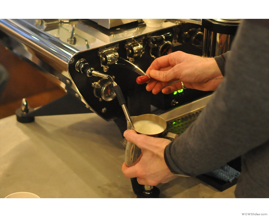 There's also coffee with milk. Here TJ does some steaming...