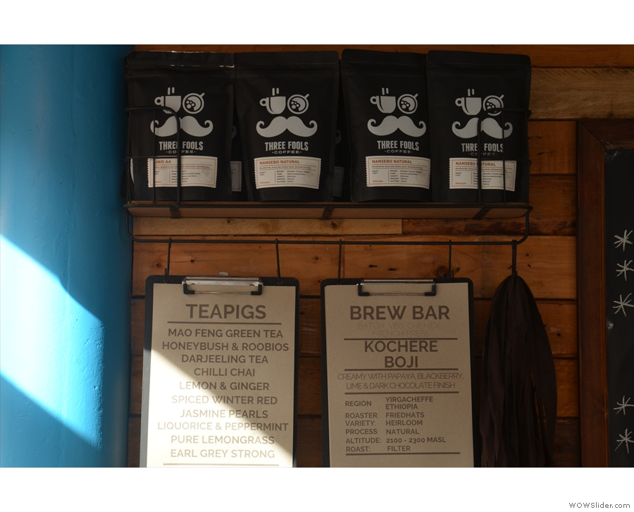 The coffee choices (along with the tea) are displayed on the back wall.