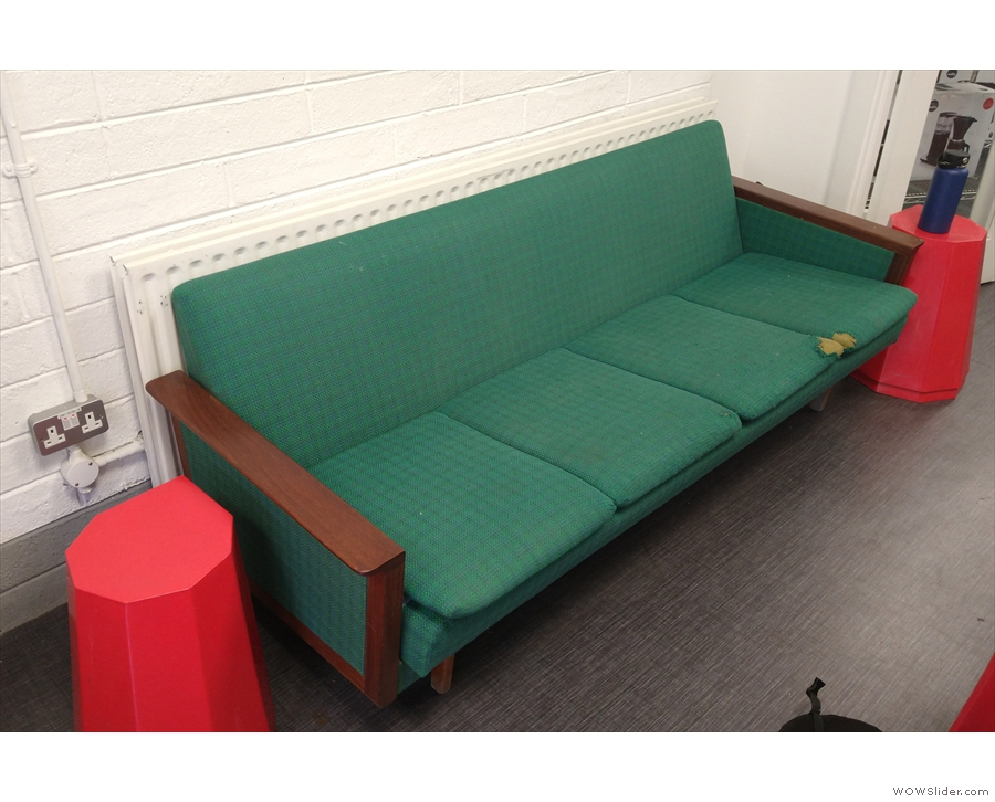 ... with a four-person green sofa against the left-hand wall.