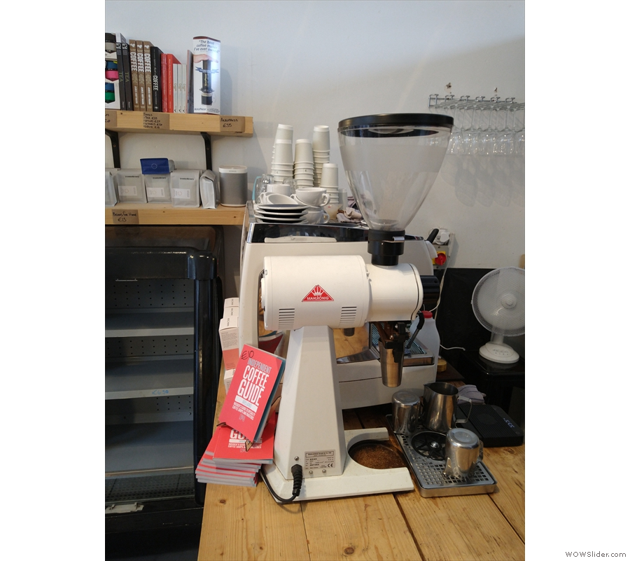 Another view of the EK43 grinder and espresso machine beyond.
