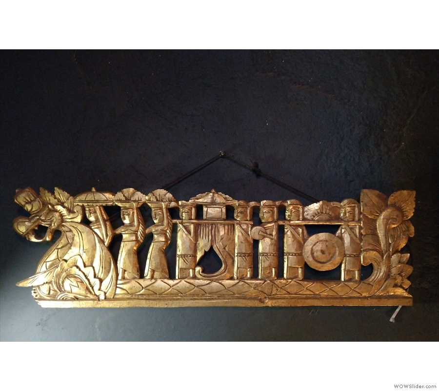 This interesting carving hangs on the wall of the landing, where you'll also find the...