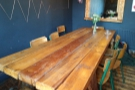 The remaining seating is provided by this magnificent eight-person communal table.