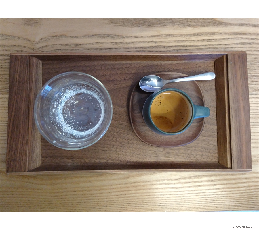 ... lovely Kinto cup, with a glass of water, it's beautifully presented on a small, wooden tray.
