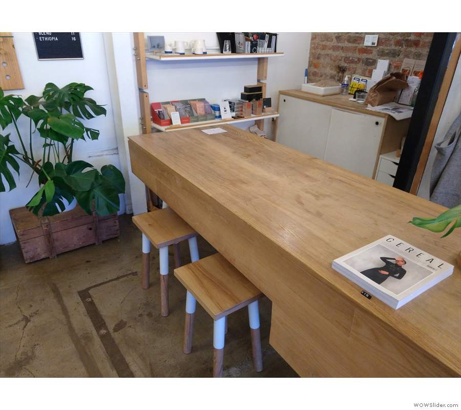 At the end of the retail counter, there are a pair of stools, providing additional seating...