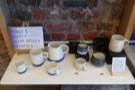 ... merchandising, including HuskeeCups (previous photo) and these lovely cups.