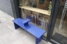 This neat bench, located to the left of the door, provides some outside seating.