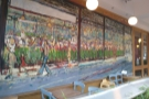 There's outside seating here, in front of the mural...