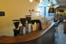 Immediately beyond the bar is the coffee counter.