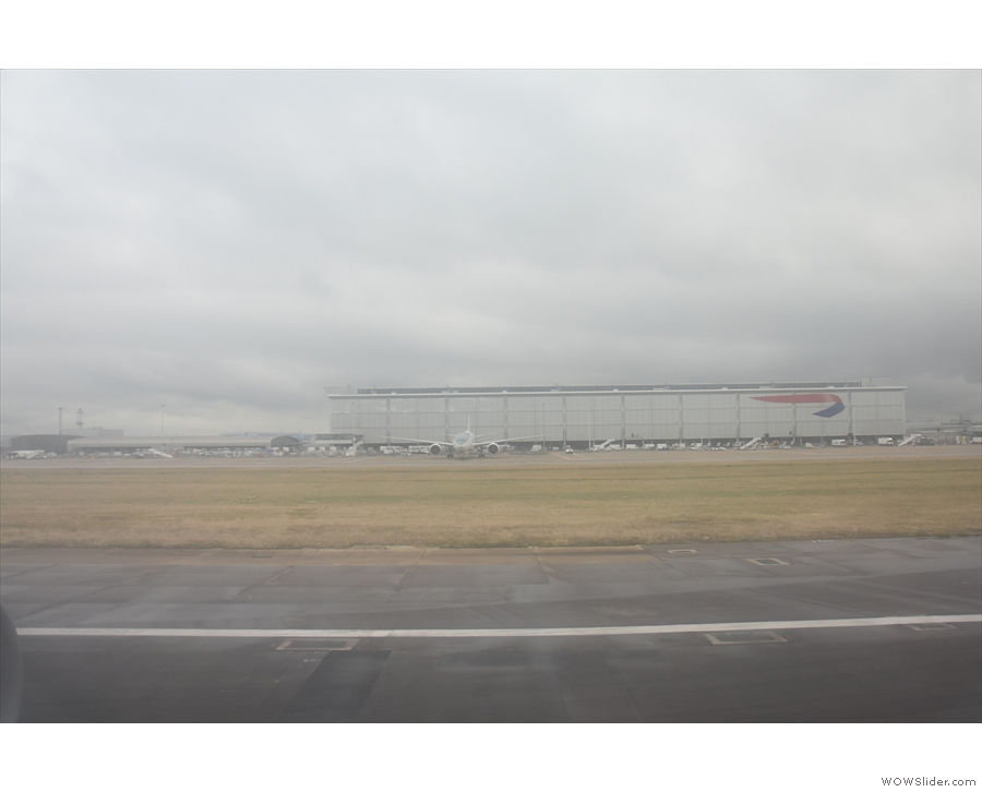 We pass a British Airways hanger as we decelerate down the runway.