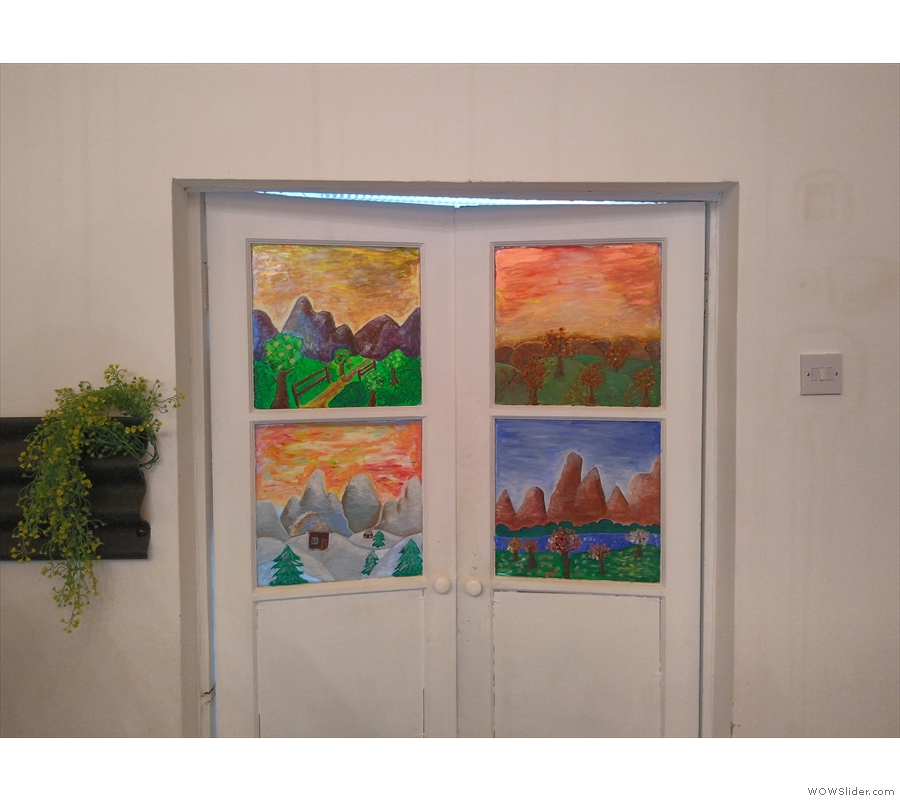 There is more painting on the doors to the kitchen behind the counter...