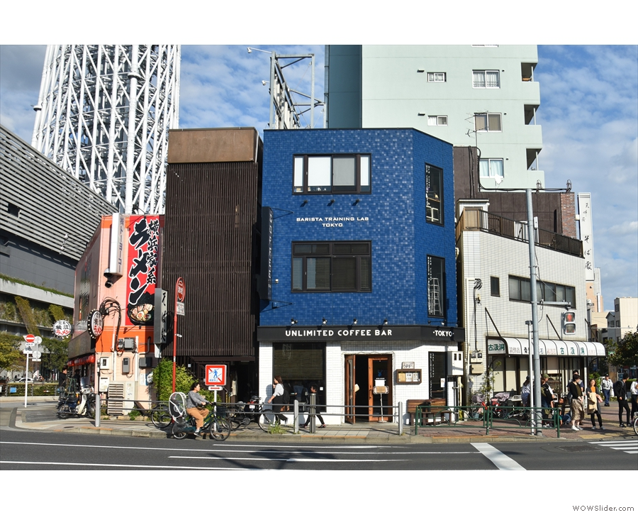 An interesting building, on a busy corner in eastern Tokyo. But what's in the background...