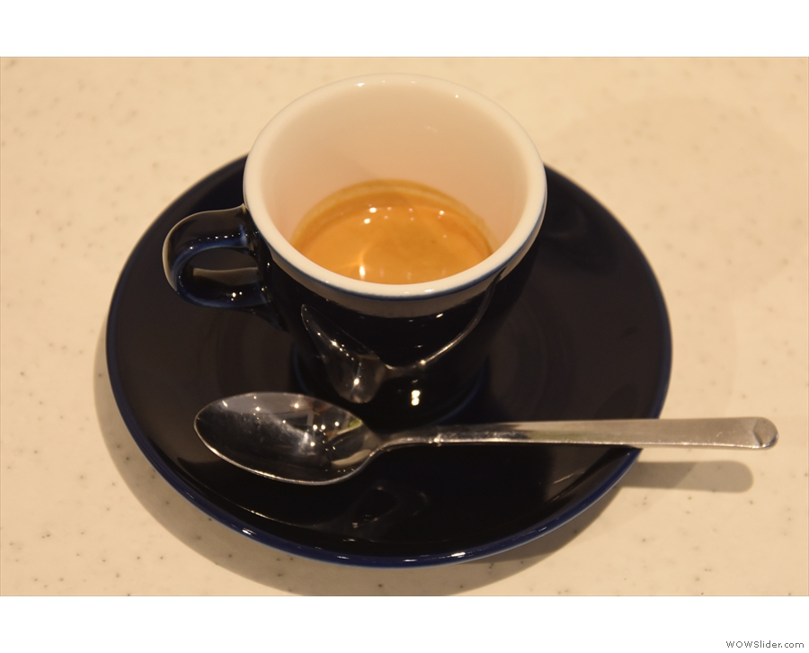 I'll leave you with my espresso, pulled short and served in a classic black cup...
