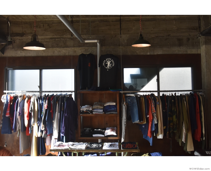 There are racks of non-branded, vintage clothing to either side.